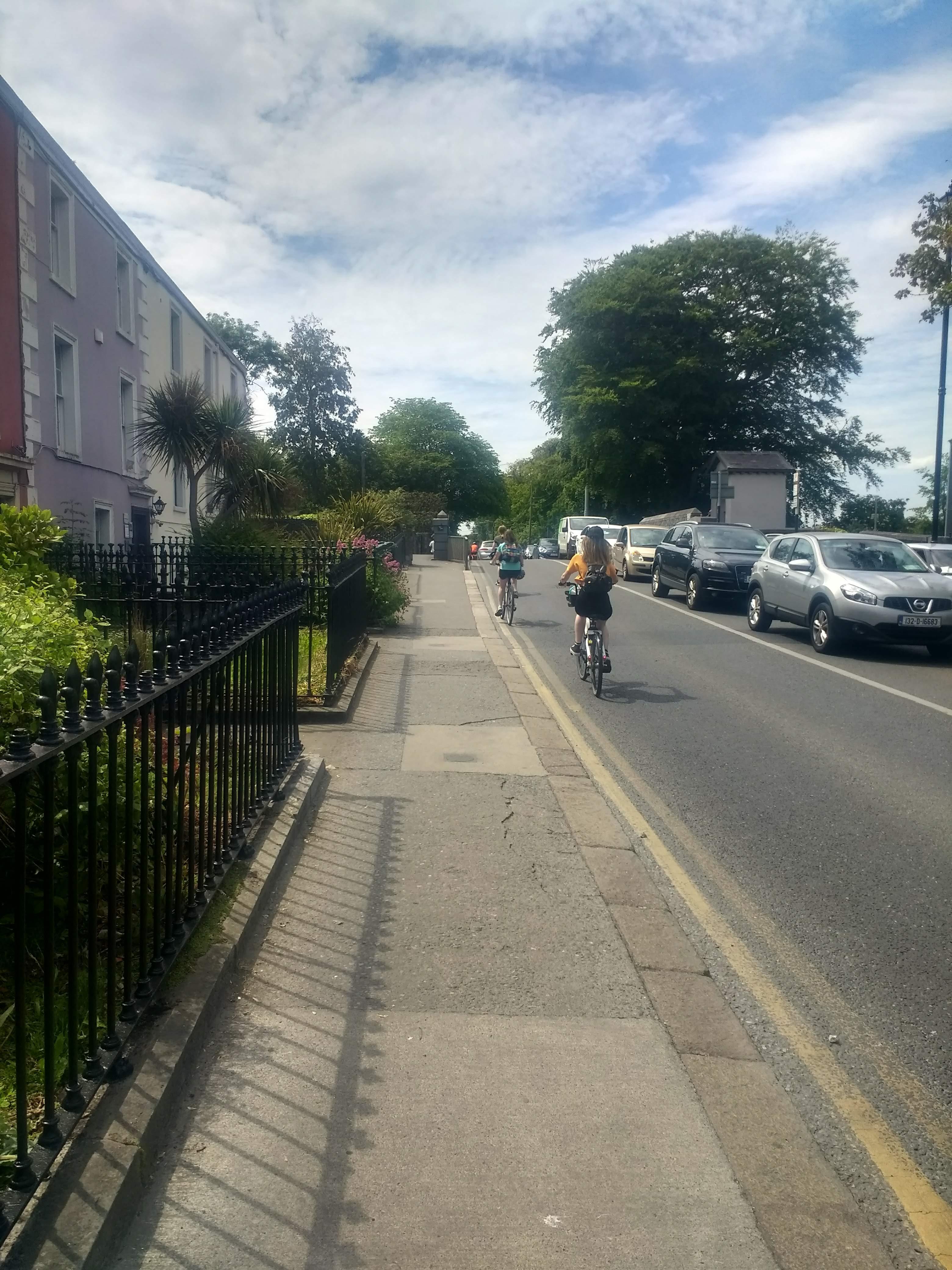 Cycling to Malahide Demesne over Railway Bridge - younger people