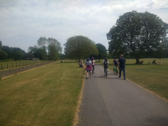Family walking and cycling in Malahide Demesne
